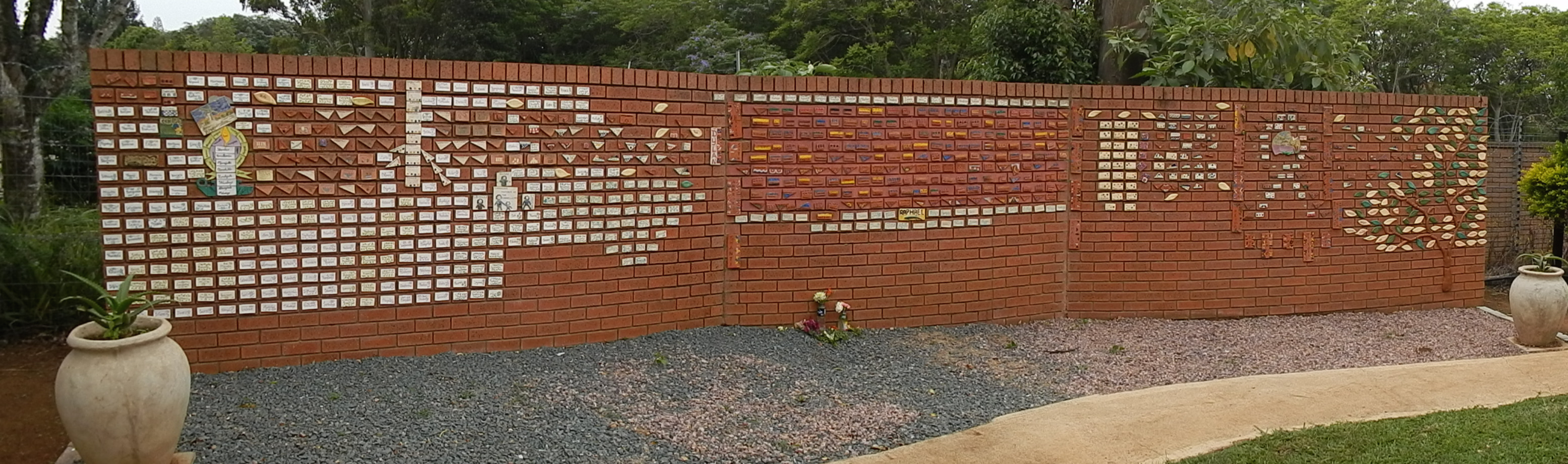 A 5-foot-tall wall of bricks that spans 20 yards and is painted with names of the patients who die here.